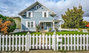 A two story house with picket fence